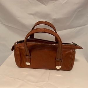 Michael Kors brown leather handbag.
